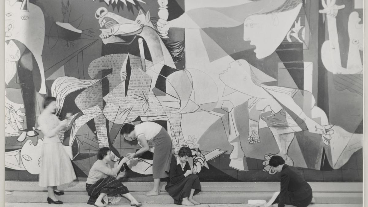 Women working in front of Guernica  in the exhibition Picasso at the Musée des Arts Décoratifs